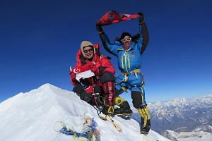 Mr Khoo and his sherpa Mingma atop the 8,463m high Makalu mountain on May 19. A team member died on the climb. Mr Khoo with his wife Wee Leng, 46; son Sheng Feng, 11; and daughter Sheng En, eight. He has insurance policies in place to make sure his f