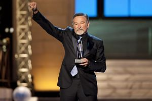 Robin Williams reacts after receiving the Stand Up Icon Award during the second annual 2012 Comedy Awards in New York on April 28, 2012. -- PHOTO: REUTERS