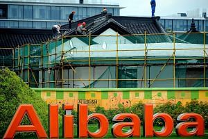 Workers renovate a building at the Alibaba head office in Hangzhou, Zhejiang province, on Sept 15, 2014. Alibaba Group Holding's initial public offering on Friday on the New York Stock Exchange looks set to make it as one of one of the largest I
