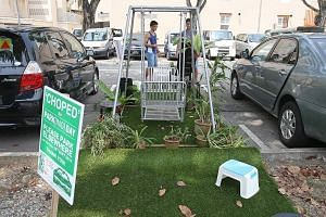 "Singapore holds its largest ever Park(ing) Day, in which people can book a lot with the URA and convert it into their own community space for a day. An installation by SUTD students titled ""My Home Garden"" occupies a parking lot along Hamilton Road."