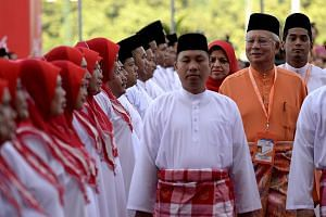 Malaysian Prime Minister Najib Razak (centre) inspects a ceremonial guard of honour during the annual congress of his ruling party, the United Malays National Organisation(UMNO) in Kuala Lumpur on Nov 27, 2014. Malaysia's Prime Minister Najib Ra