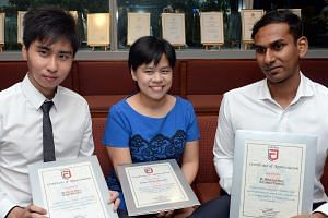 (From left) Mr Wilson Benedict Lim, Dr Jacqueline Yam and Mr Mohamed Nazir Abdul Rahiman received police commendations for helping to detain the suspect and tending to the victim in the Nov 14 robbery in Raffles Place.