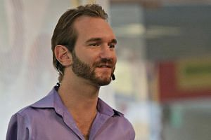 Motivational speaker Nick Vujicic (above) may not be able to hold his son Kiyoshi, but he tries to be the best father he can be, so the boy will hug him. -- PHOTO: EDDY WEE