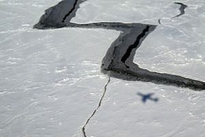 This Oct 27, 2014 handout photo provided by NASA shows the shadow of NASA's DC-8 on Antarctic sea ice. -- PHOTO: AFP