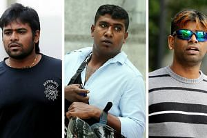 (From left) Ramachandra Chandramohan, Jaya Kumar Krishnasamy and Gunasegaran Rajendran were charged in court on Saturday morning for disorderly behavior and attacking police officers at a Thaipusam event held earlier in the week. -- ST PHOTOS: WONG K