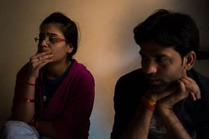 Indian couple Ms Vandana, 22, and Mr Dilip, 28, describe how they met and the pressure they faced from their relatives after deciding to marry during an interview with AFP at one of seven shelters for coupes who have left their homes to marry against