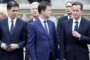 Ed Miliband (left) who today resigned as leader of the Labour Party, Nick Clegg who today resigned as leader of the Liberal Democrats (centre), and Britain's Prime Minister David Cameron (right) pay tribute at the Cenotaph to mark the 70th anniversar
