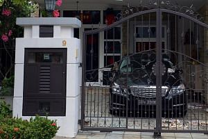 A Mercedes-Benz and a BMW were seen parked at the Tanah Merah semi-detached house of Madam Leong Lai Yee. Madam Leong who allegedly owes more than 60 investors around $60 million, has just over $5,000 in a joint bank account with her husband. -- ST P