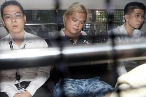 Jover Chew Chiew Loon, the owner of Mobile Air, was charged in court on Friday morning with cheating a total of 25 victims at his now-defunct Sim Lim Square shop. -- ST PHOTO: SEAH KWANG PENG