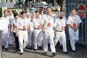 PM Lee Hsien Loong (front) arriving at the Chong Boon Secondary School polling station with his fellow PAP candidates for the Ang Mo Kio GRC during the General Election in 2011. The party may be firming up its slate, but electoral boundaries for the