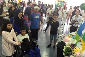 Tanjong Katong Primary School pupil El Wafeeq El Jauzy (in wheelchair), who survived the earthquake. -- PHOTO: THE NEW PAPER