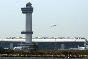 The control tower of John F. Kennedy airport in New York, on May 25. A computer glitch has caused the United States to be unable to make visas to worldwide visitors for two weeks.