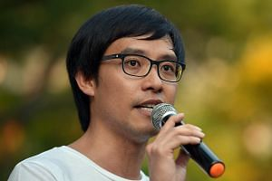 Roy Ngerng speaking at the Labour Day protest at Hong Lim Park.