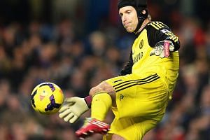 Chelsea goalkeeper Petr Cech in action during the English Premier League soccer match. Cech has agreed to join Arsenal.
