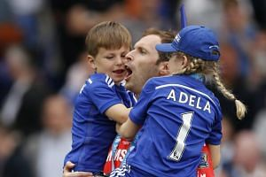 Chelsea's Petr Cech celebrates with family after winning the Barclays Premier League in April.