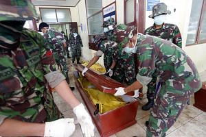Bodies that have been identified are returned to families, while those that need DNA tests for identification are sent to Jakarta.