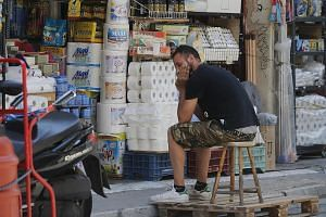 A shopkeeper waiting for customers outside his shop in Athens. According to the National Confederation of Hellenic Commerce, the economic uncertainty has meant an average of 59 businesses closing down every 24 hours in recent months.