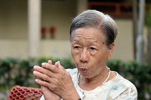 Residents of Ghim Moh estate often hear their neighbour Theresa Lee even before they see her - her trademark whistling announces her presence as she roams the neighbourhood.