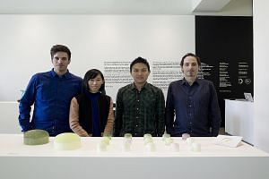 Outofstock's (above from left) Sebastian Alberdi, Wendy Chua, Gabriel Tan and Gustavo Maggio. (Below) A set-up from the Sori Yanagi exhibition in Singapore they designed.