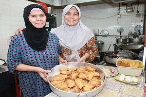 (Above) Mother Jamilah Karim's and daughter Aminah Abdul's curry puff recipe has remained the same for more than 20 years.