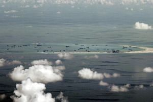 An aerial file photo taken though a glass window of a Philippine military plane shows the alleged on-going land reclamation by China on Mischief Reef in the Spratly Islands in the South China Sea, west of Palawan, Philippines, May 11, 2015.