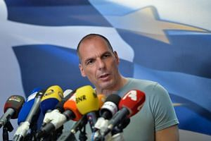 Greek Finance Minister Yanis Varoufakis gives a press conference in Athens on July 5, 2015.