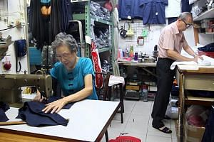 Husband and wife pair Chang Kok Liang and Chan Wai Yoke, both 79, have been working as tailors at the Army Market, selling uniforms for the Singapore Armed Forces and other student uniformed units since 1980.