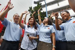 Workers' Party (WP) chief Low Thia Khiang, MP Lee Li Lian, WP chairman Sylvia Lim and other WP MPs at a thank-you parade after winning the Punggol East by-election in 2013. PHOTO: ST FILE