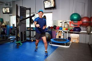Retiree William Gan, 69, demonstrating some exercises he was prescribed under the Exercise is Medicine programme.