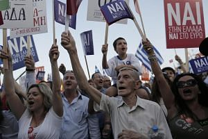 Protesters at a rally in Athens demanding that Greece remain in the Eurozone.