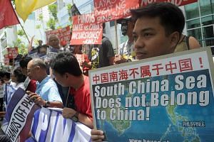Protesters at a rally in front of the Chinese Consulate in Manila's financial district.
