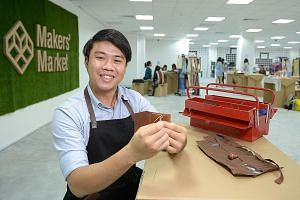 Mr Sylvester Ng (right) enjoys working with leather, making wallets and cardholders (far right) with the material.