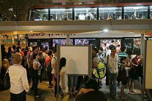 Commuters at Lavender Station, who were directed to the nearest bus stop, found that many people were ahead of them, including those from nearby stations such as Bugis. This led to huge crowds waiting to board the buses. SMRT staff putting up a sign