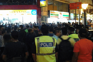 A crowd of about 100 gathered outside the shopping mall on Sunday night.