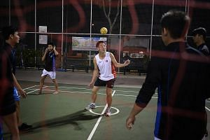 Dr Tan Lai Yong playing sepak takraw with migrant workers at Westlite Dormitory in Mandai Estate on June 25.