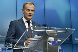 Euro zone leaders reached a unanimous agreement after all-night talks in Brussels to move forward with a bailout loan for Greece, European Council President Donald Tusk said on Monday.