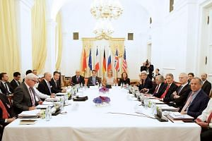 World leaders take a photograph during talks between the E3+3 (France, Germany, UK, China, Russia, US) and Iran, in Vienna, Austria, on July 7, 2015.