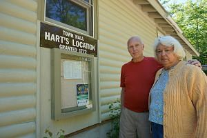Mr Bill King, the town's fire warden, and his wife Carolyn outside the town hall in Hart's Location. The whole process of voting, closing the polls and counting the votes reportedly takes just eight or nine minutes.