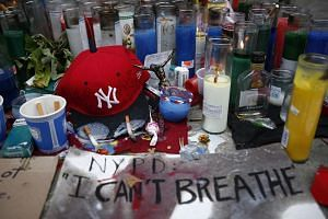Candles are seen at the memorial of Eric Garner in Staten Island, New York.