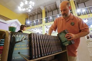 Manager Justin Colussy-Estes prepares copies of Harper Lee's new novel Go Set A Watchman for sale at the Little Shop of Stories in Decatur, Georgia.
