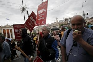 Protesters at a rally organised by the country's biggest public sector union Adedy in Athens on May 11.