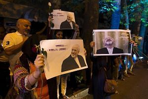 Iranians displaying pictures of Foreign Minister Mohammad Javad Zarif as they celebrated in the streets of Teheran after the country struck a nuclear deal with major world powers on Tuesday, a move seen as a game-changer.