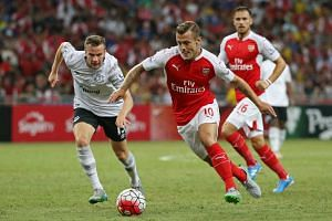 Arsenal's Jack Wilshere (right) and Tom Cleverley of Everton (left).