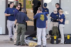 FBI investigators prepare to probe the Chattanooga, Tennessee, shootings.