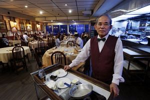 Shashlik waiter Foo Sek Chuan, 75, in the Russian restaurant, which will close come the end of the year.