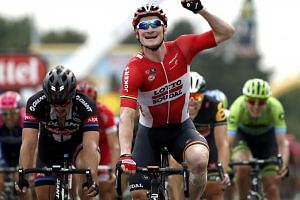 Andre Greipel crossing the the finish line of the 183km Tour de France 15th stage.