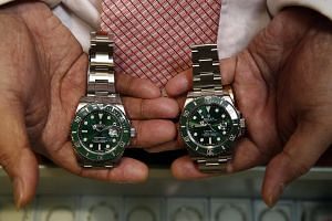Peter has spent about $2,000 on his fake watches.