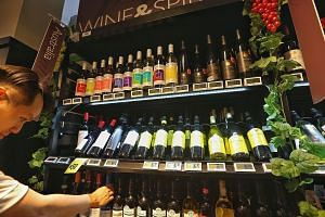 Those who enjoy a glass of Australian wine have been served a little better by the currency's downturn. Australian wines retailing above $40 a bottle have fallen between 4 per cent and 7 per cent over the past year, with wines above $80 enjoying the