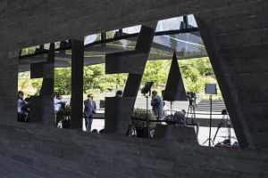 Journalists wait in front of the FIFA headquarters in Zurich, Switzerland on July 20, 2015.