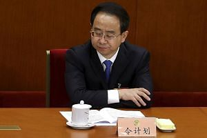 Mr Ling Jihua at a Beijing meeting in this March 2013 file picture. He is one of the highest ranked politicians nailed under China's current corruption crackdown.